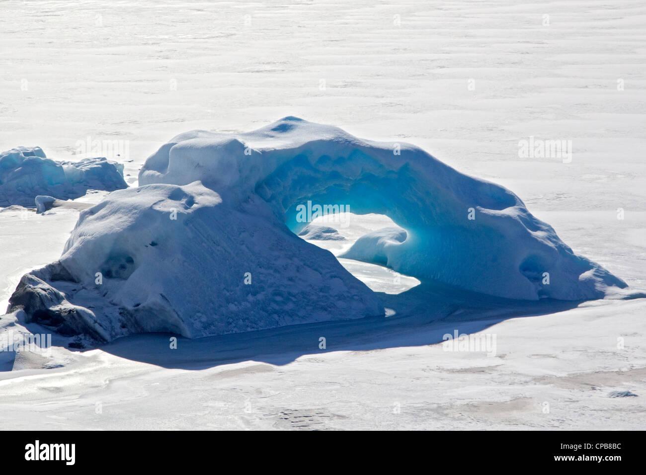 Frozen blue ice arch on glacier, Alaska, USA - Stock Image