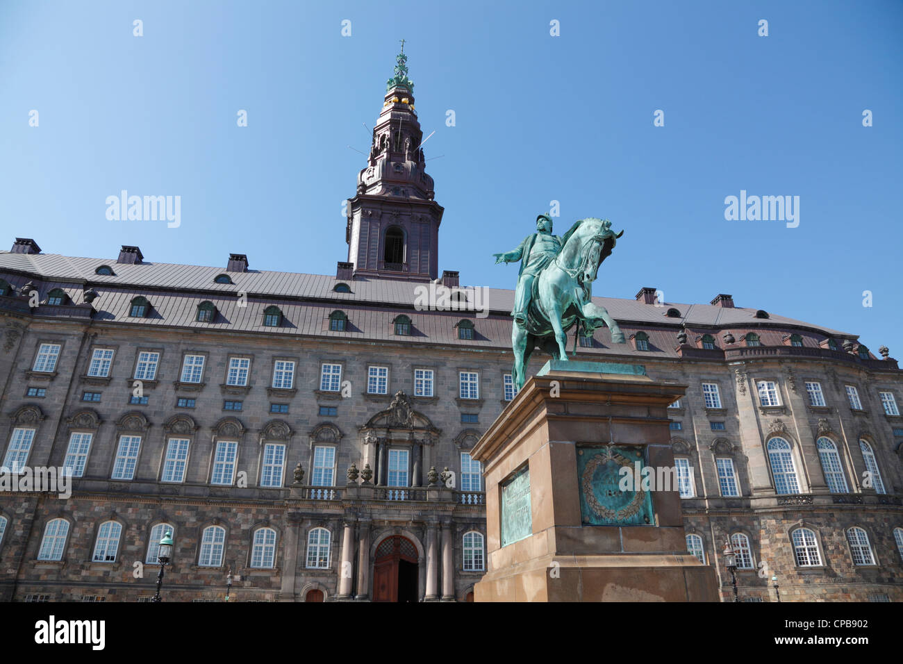 The castle and square of Christiansborg Castle with the equestrian statue. The Danish Parliament building in Copenhagen, - Stock Image