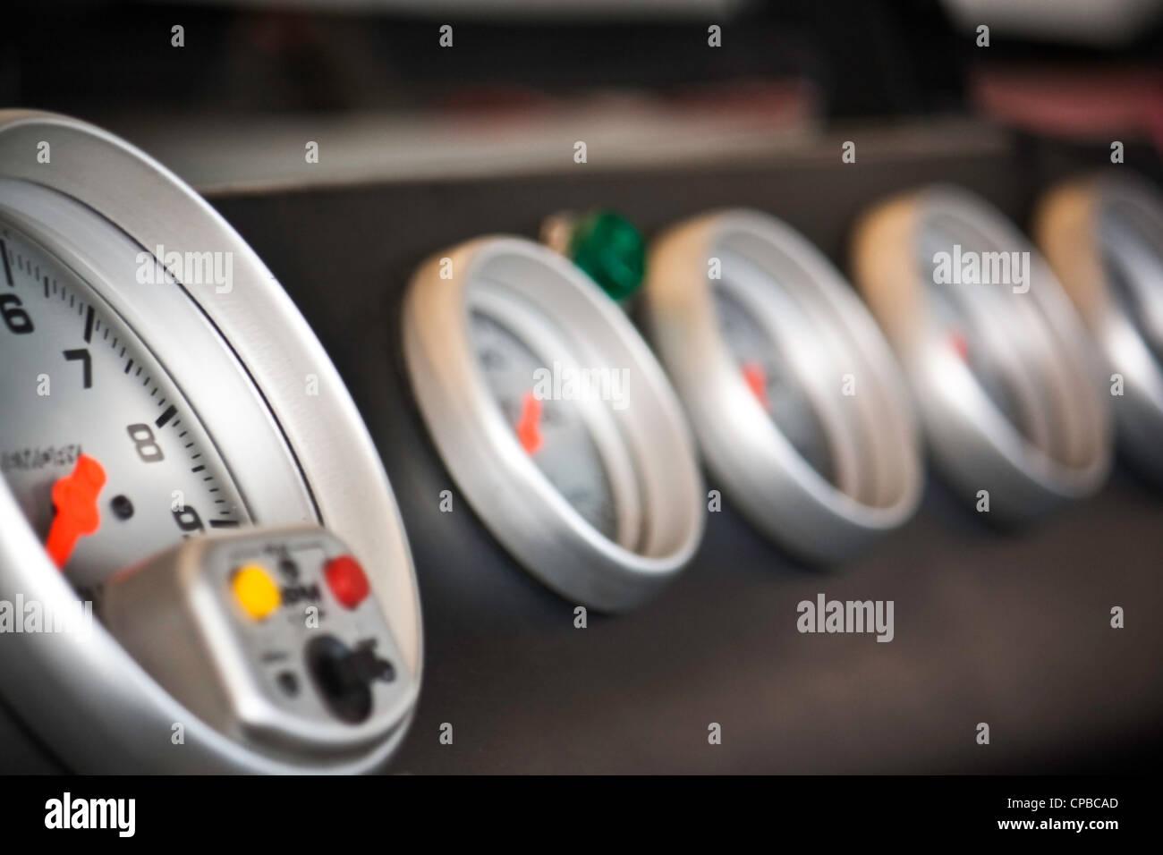race car dials inside a nascar style vehicle - Stock Image
