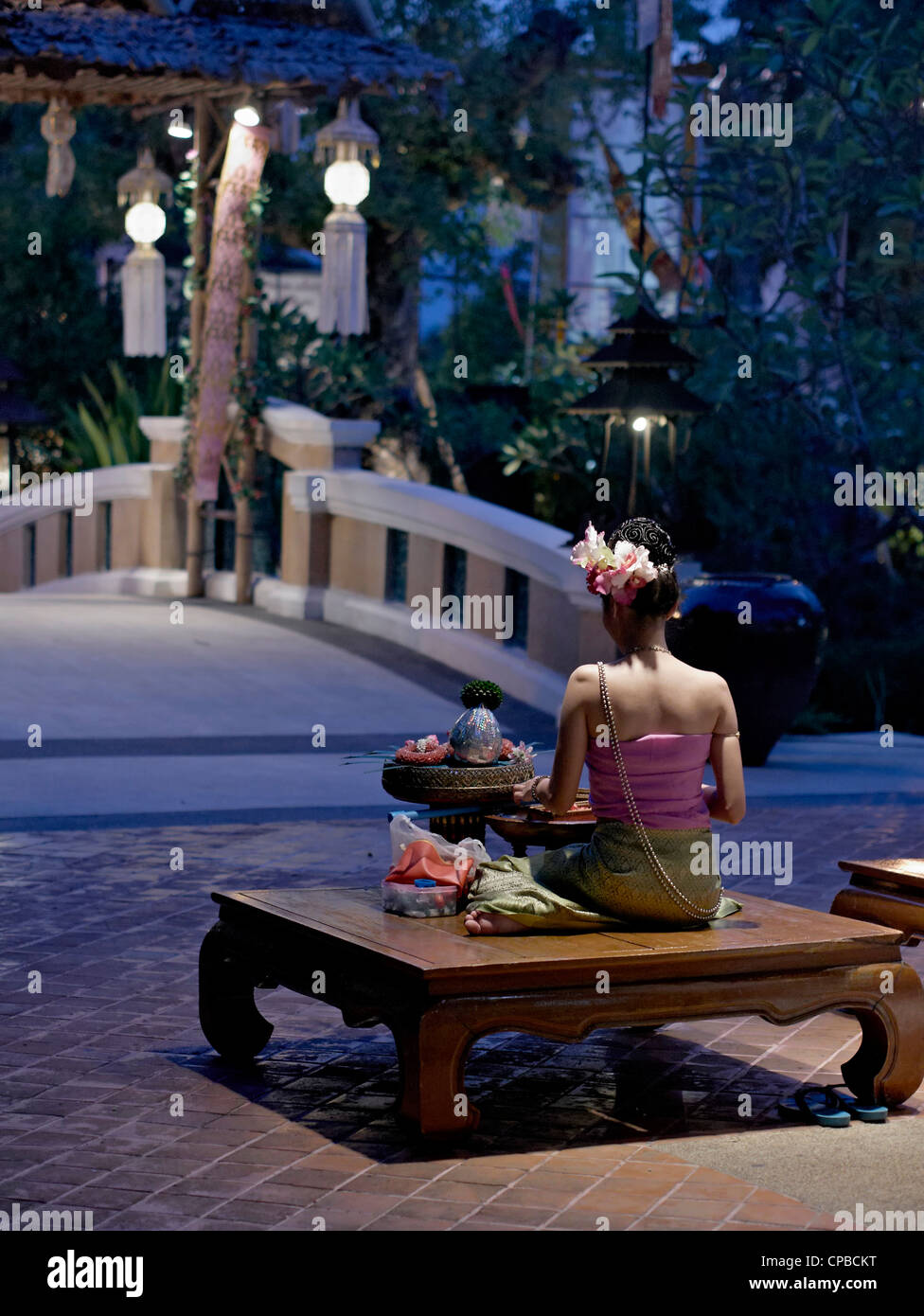 Thailand restaurant receptionist Traditionally dressed awaits to greet guests. Thailand S. E. Asia - Stock Image