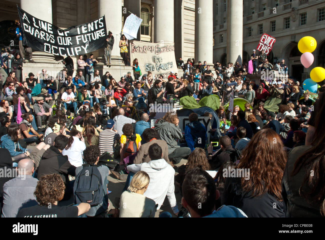 Occupy, London UK. Anti capitalism demonstration in the financial district, part of a global day of action. At Bank - Stock Image