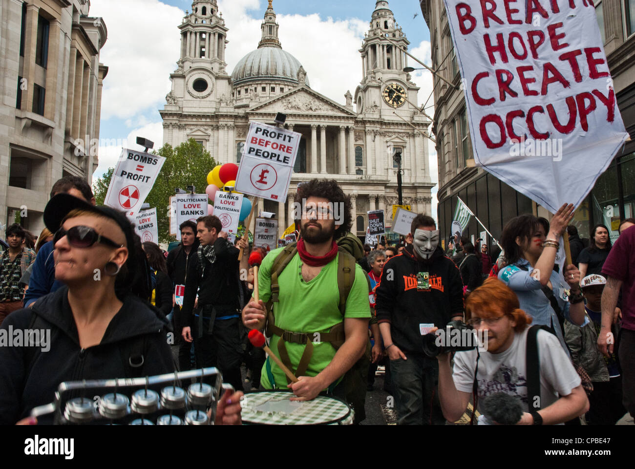Occupy, London UK. Anti capitalism demonstration in the financial district, part of a global day of action. - Stock Image