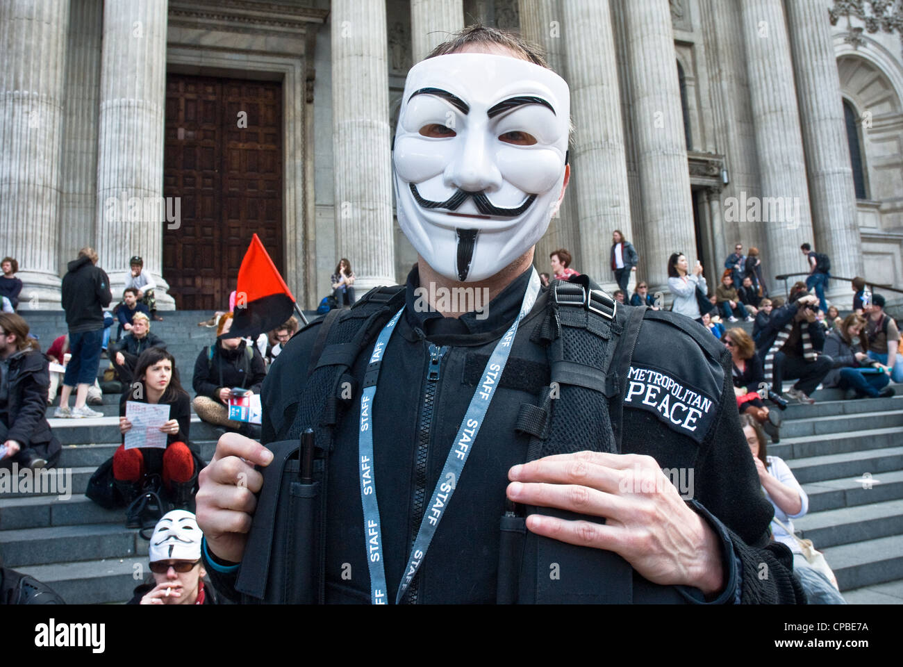 Occupy, London UK. Anti capitalism demonstration, part of a global day of action. Protester in anonymous Guy Fawkes - Stock Image