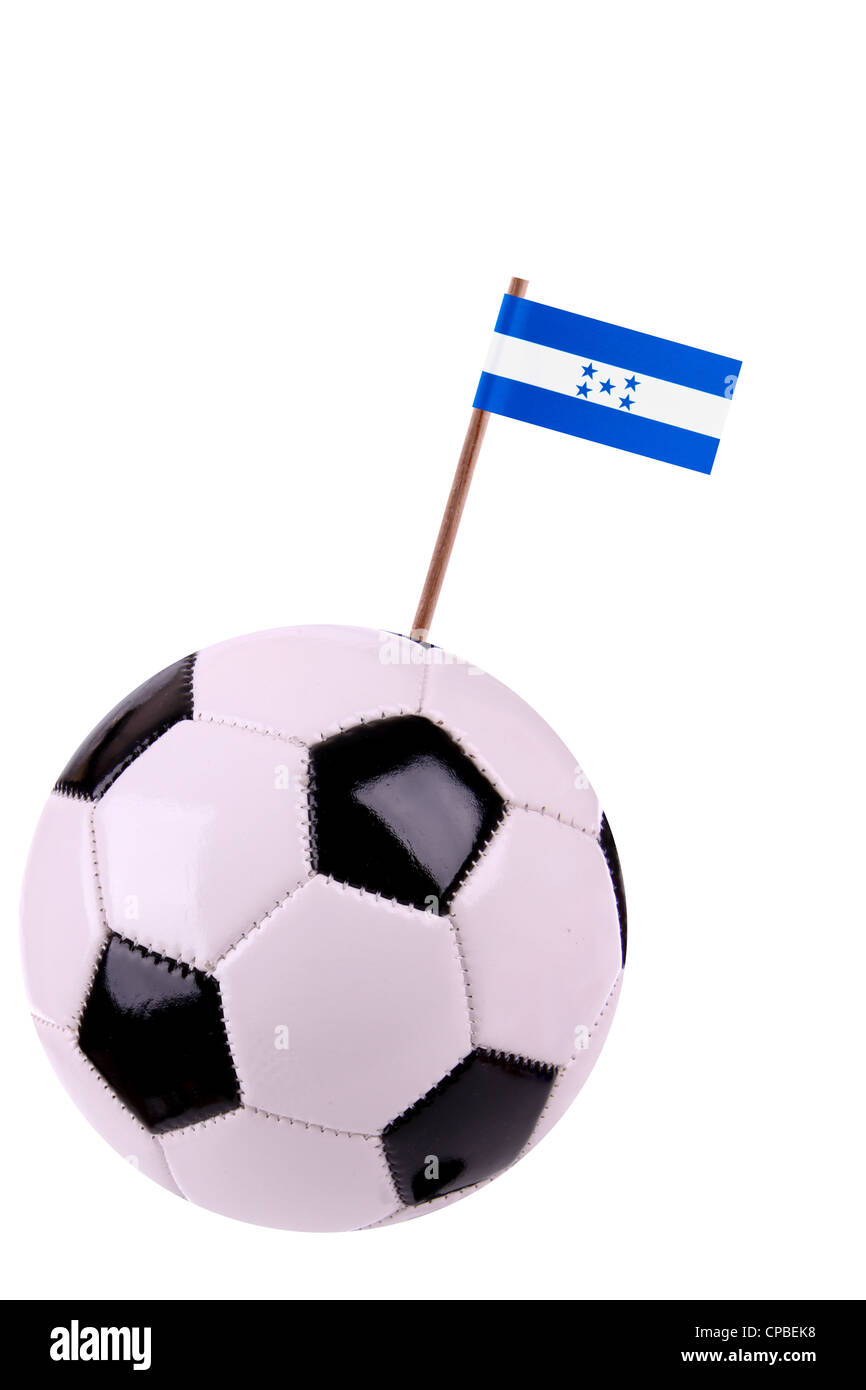 Soccerball or football decorated with a small national flag on a toothstick Stock Photo