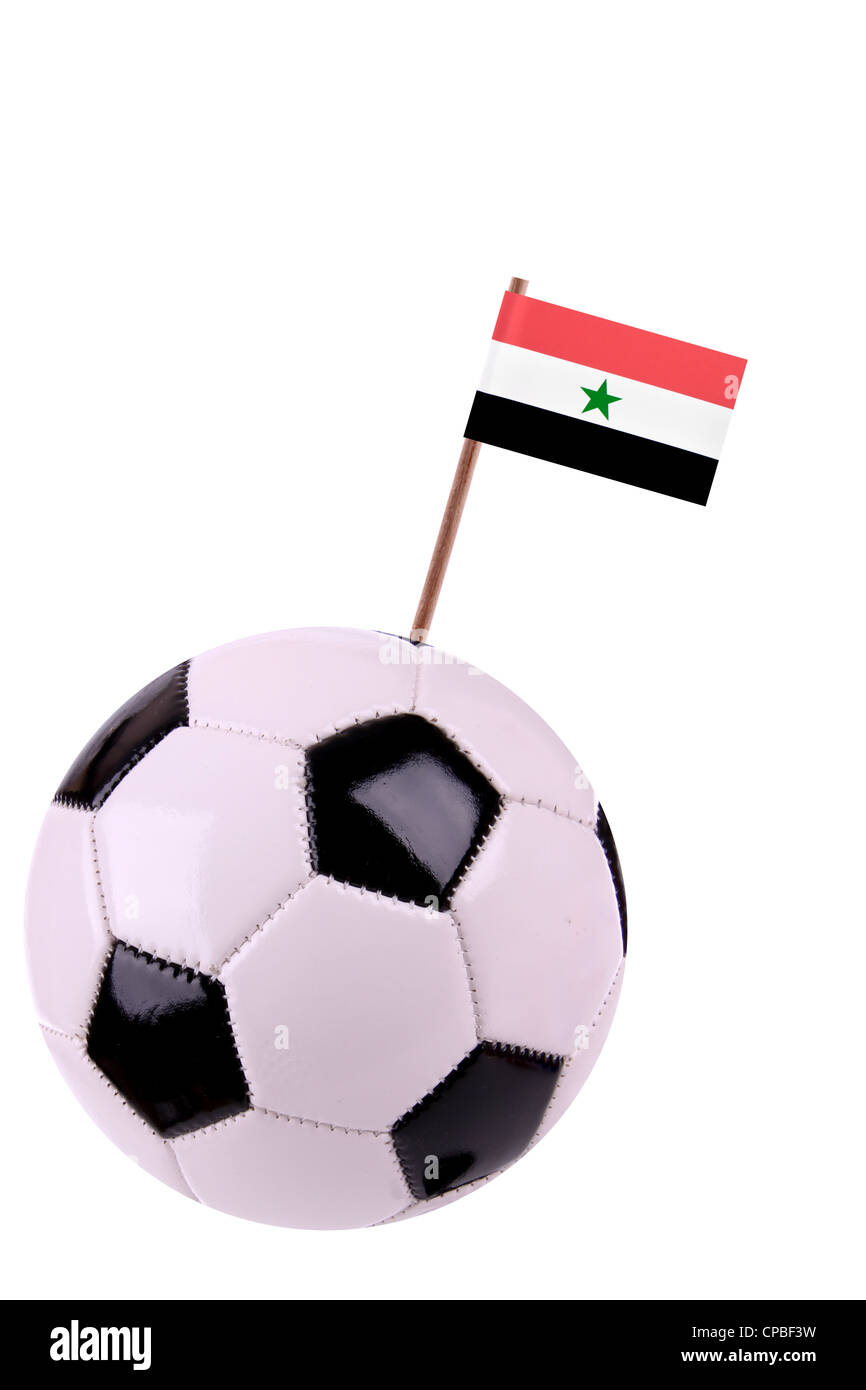 Soccerball or football decorated with a small national flag on a toothstick - Stock Image