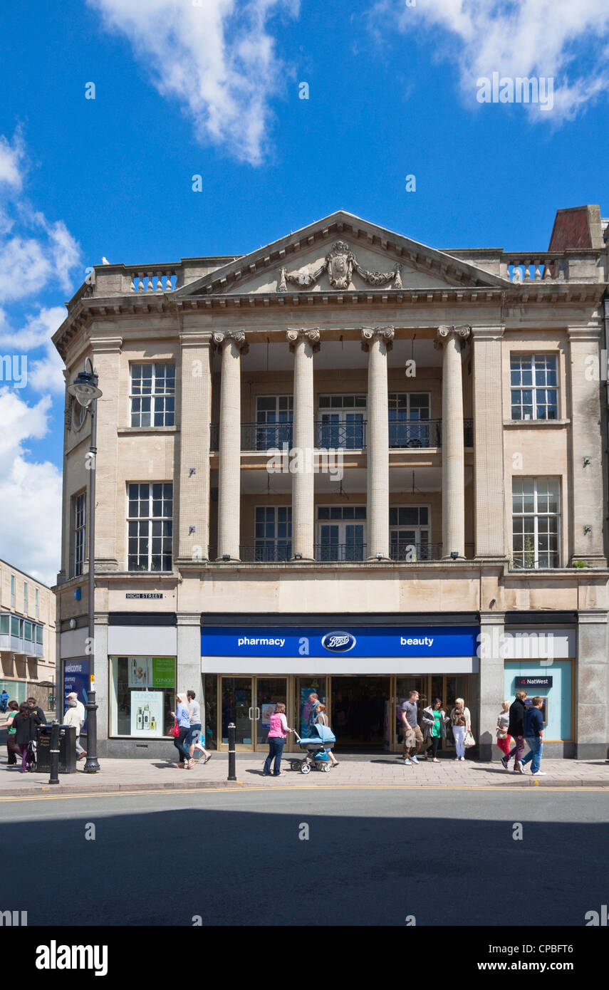 Boots the Chemist - occupying a very grand classical building on the High Street, Cheltenham, Gloucestershire, UK. - Stock Image