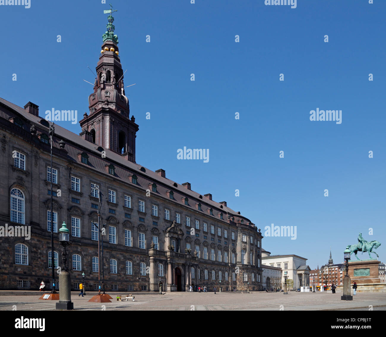 The palace and square of Christiansborg Palace with the equestrian statue. The Danish Parliament building in Copenhagen, - Stock Image