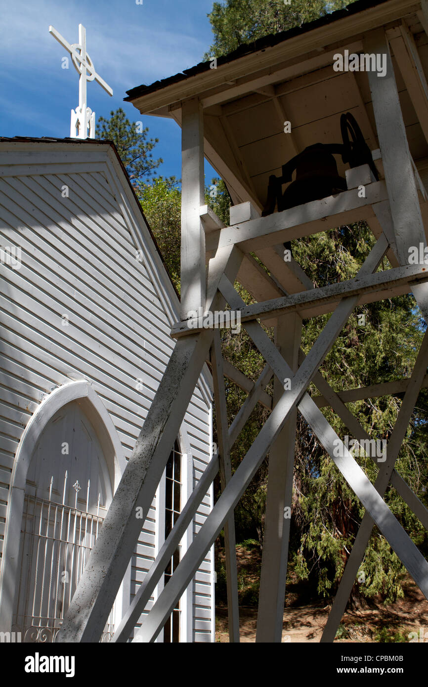 A view looking up at the cross and bell tower at Saint Johns Catholic Church at the Marshall gold discovery Coloma - Stock Image