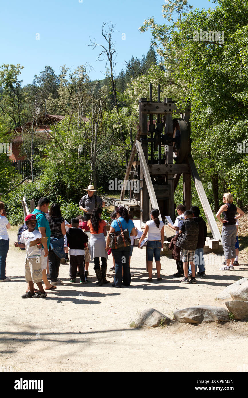 Tourists and school children at the California Stamp Mill Marshall Gold Discovery Coloma . - Stock Image