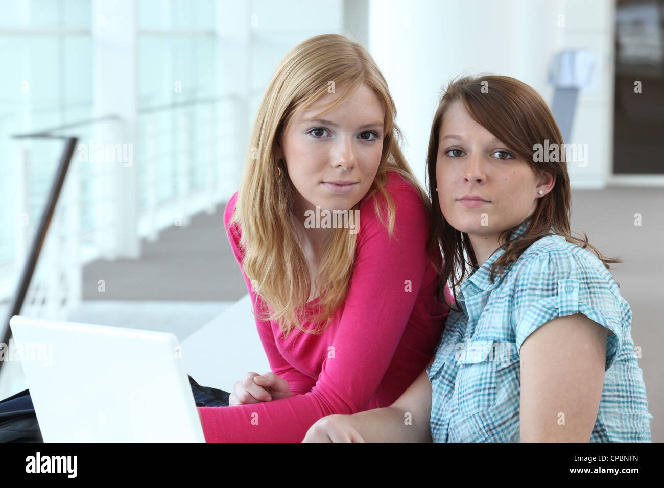 female duo in office - Stock Image