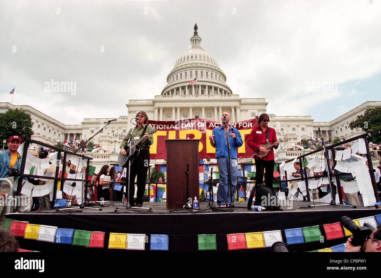 Singer Michael Stipe, guitarist Peter Buck and Mike Mills of REM perform at the Rally for Tibet at the US Capitol - Stock Image