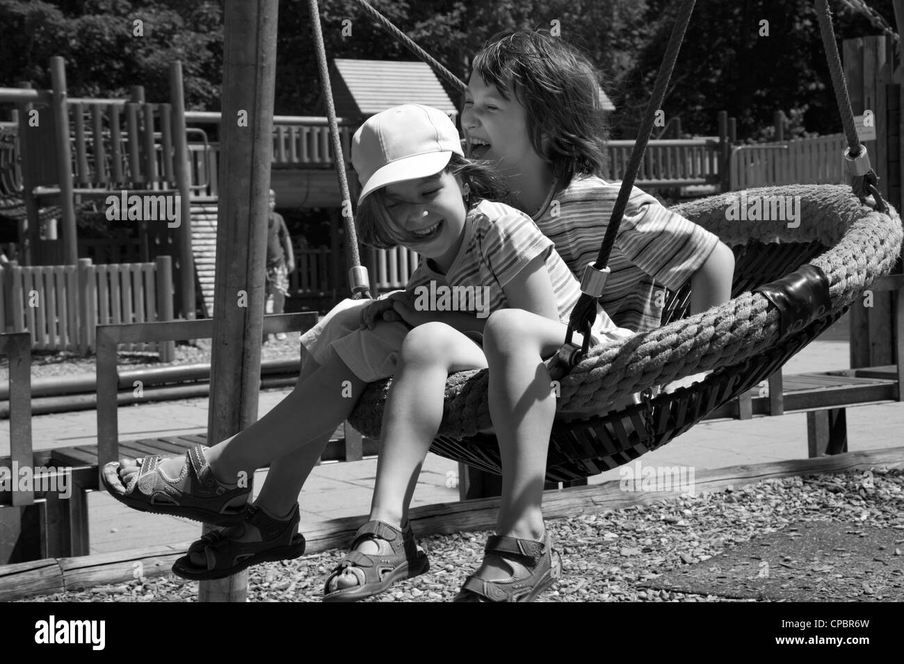 fun of little girls on the seesaw - Stock Image