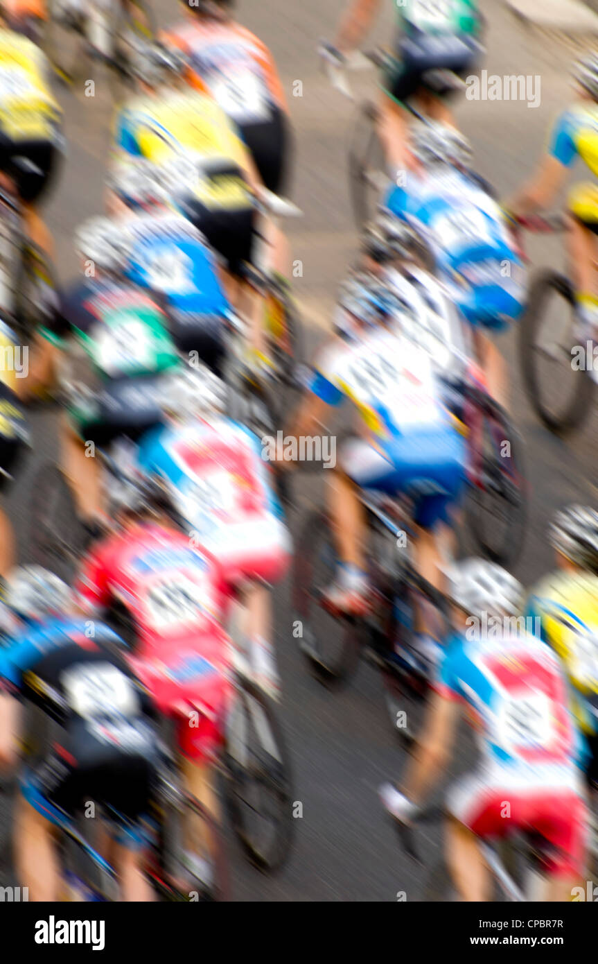 group of cyclists during a road cyclist racing competition, with motion blur effect, almost abstract - Stock Image