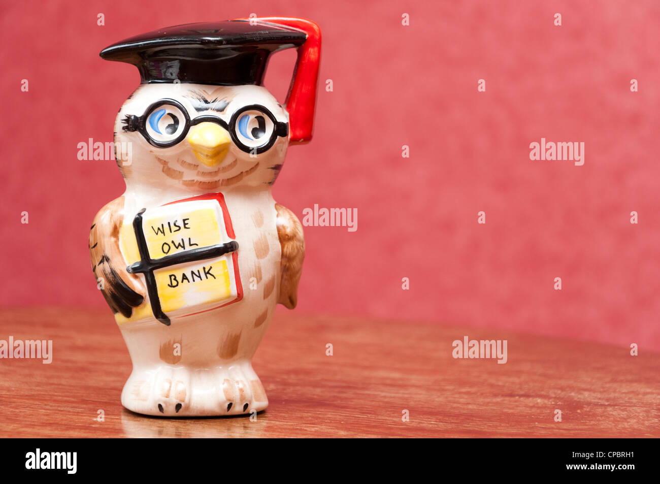 Wise owl money savings bank. - Stock Image