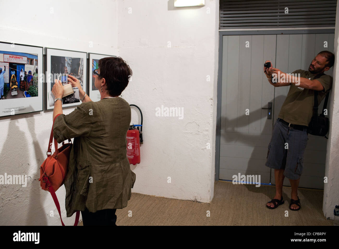 Visitors at one of the exhibitions of Visa Pour l'Image 2011 photography festival, Perpignan, France - Stock Image