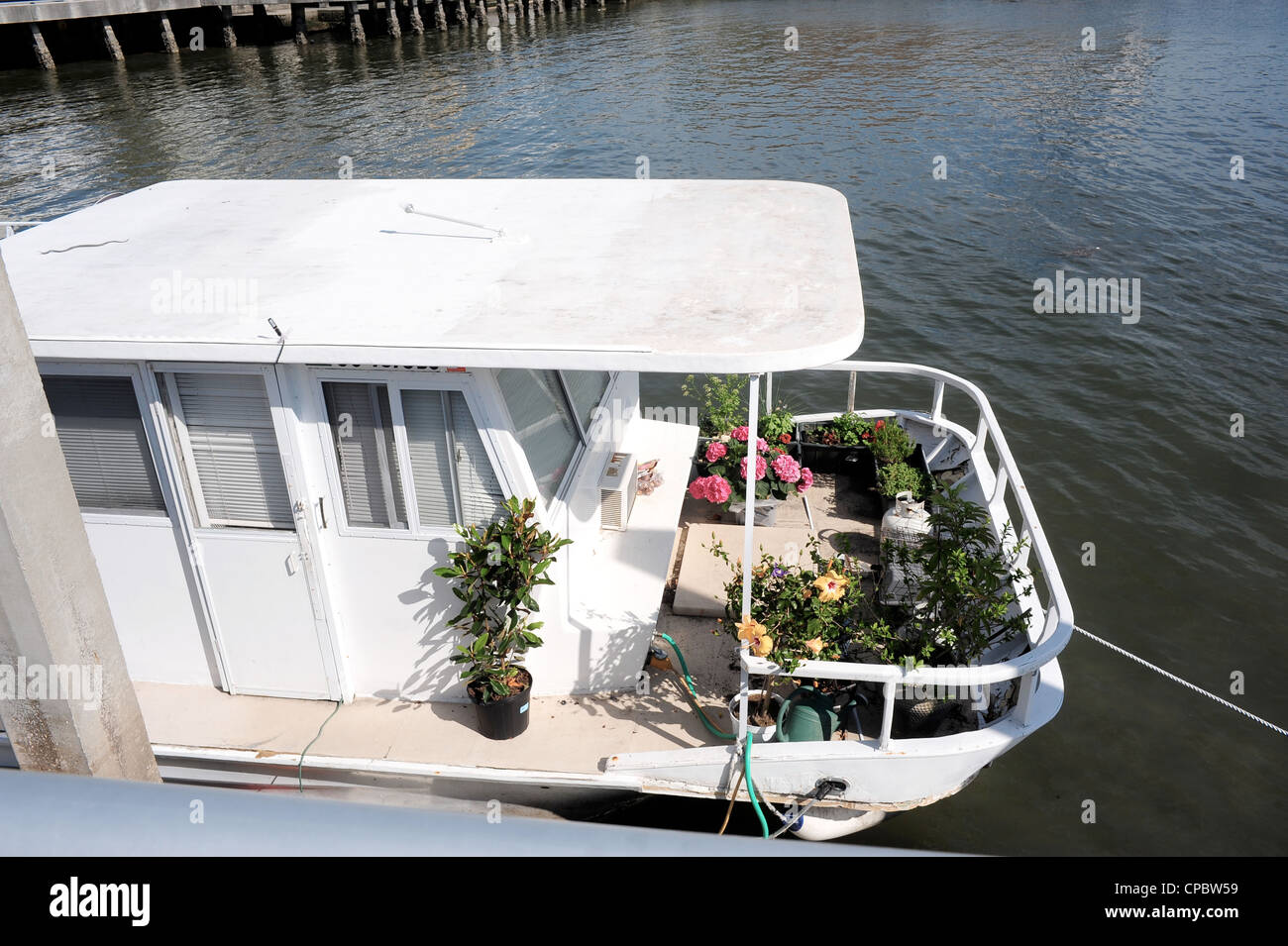 Houseboat with potted plants - Stock Image