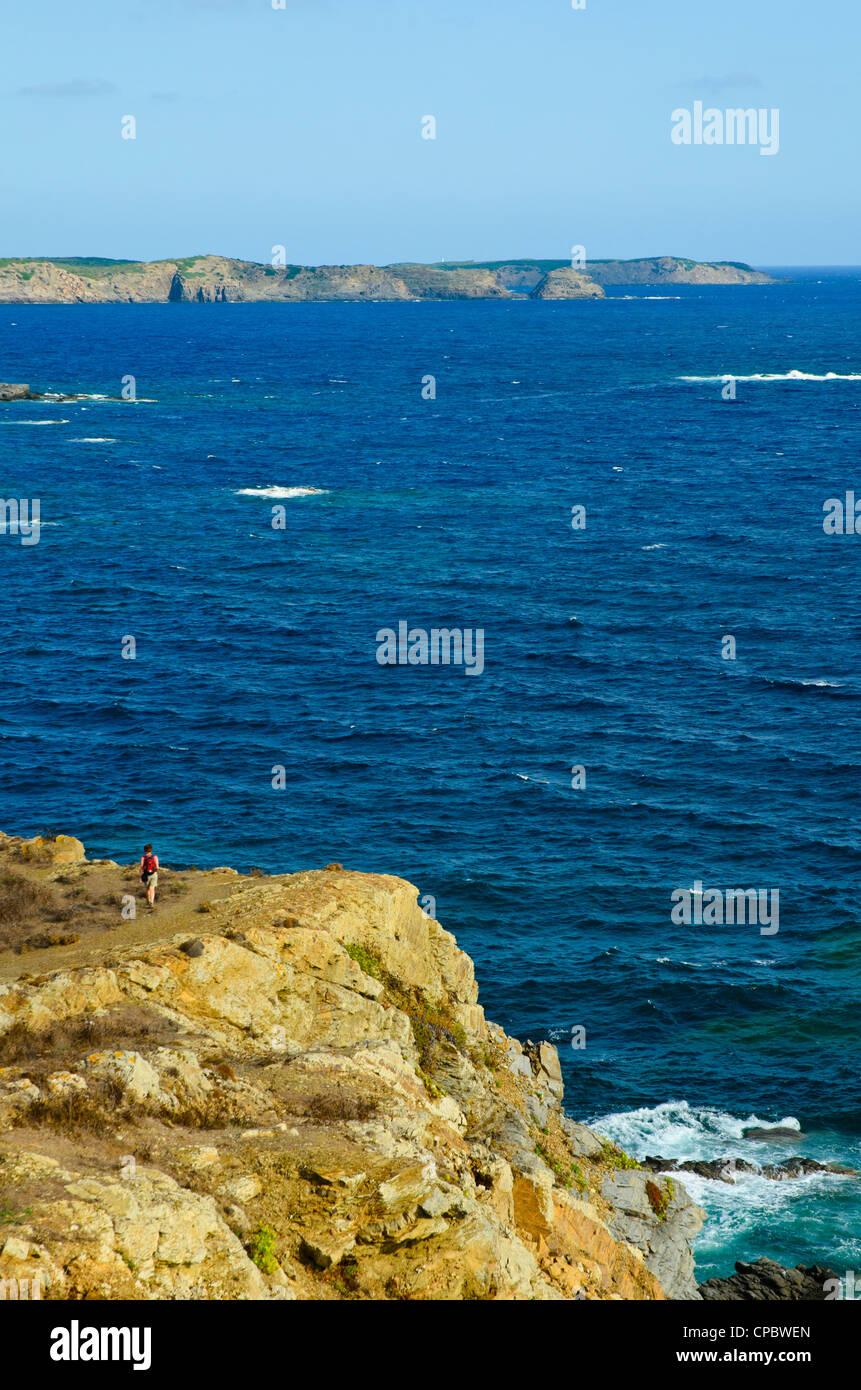 Walker on Illots de Sa Mesquida on Menorca in the Balearic islands, Spain - Stock Image