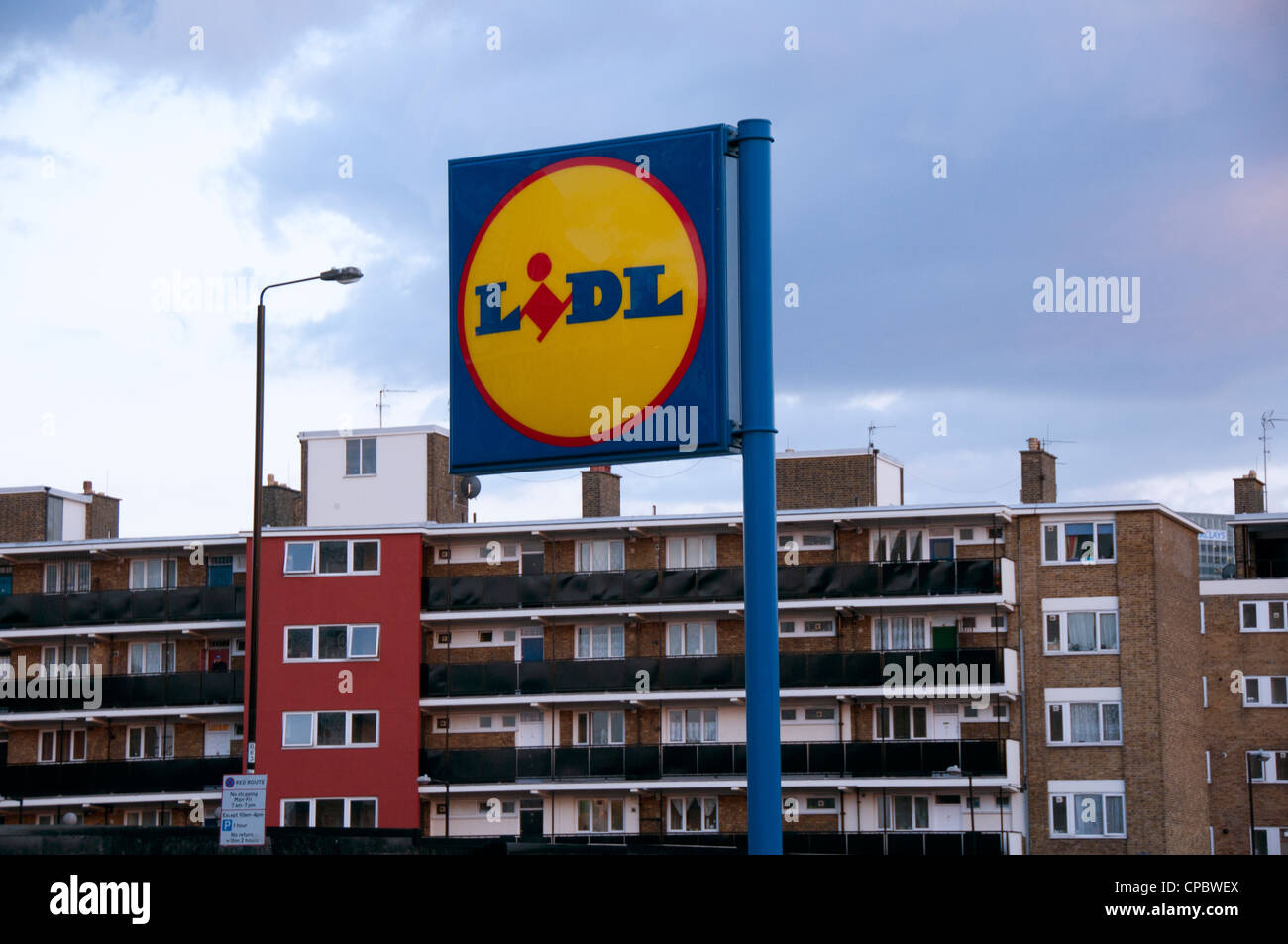 Lidl sign with council housing behind in East London - Stock Image