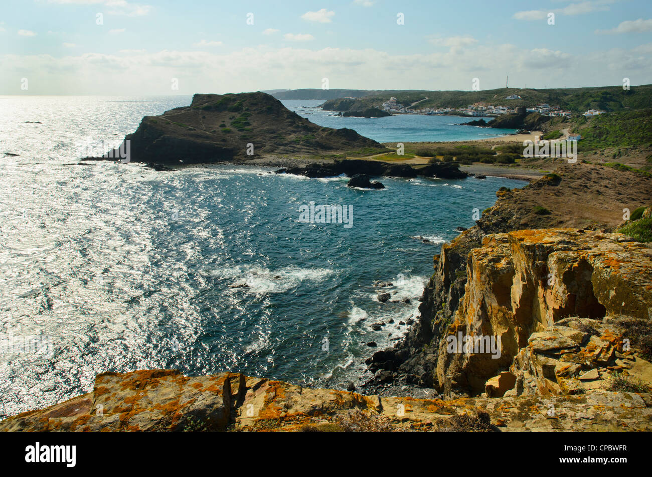 Looking south over Illots de Sa Mesquida to the village of Sa Mesquida on Menorca in the Balearic islands, Spain - Stock Image