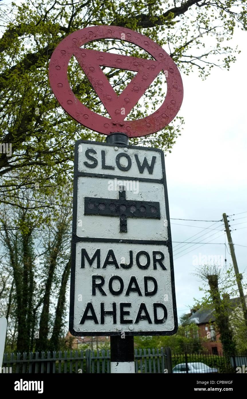 Slow Major Road Ahead Road Sign -1 Stock Photo