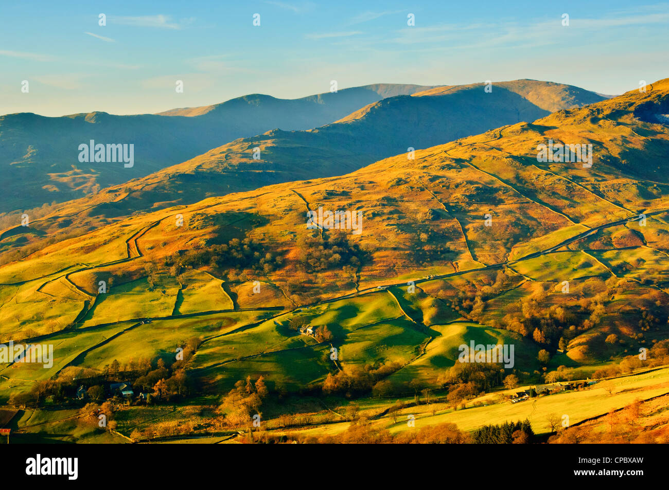 Evening view from Wansfell Lake District over the Troutbeck valley and slopes of Red Screes to the Fairfield Horseshoe - Stock Image