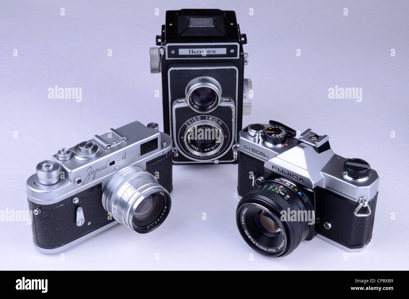 A Collection of cameras spanning the 1950's to the 1970's. Zeiss Ikon Ikoflex, Zorki 4 and Fujica ST605N Stock Photo