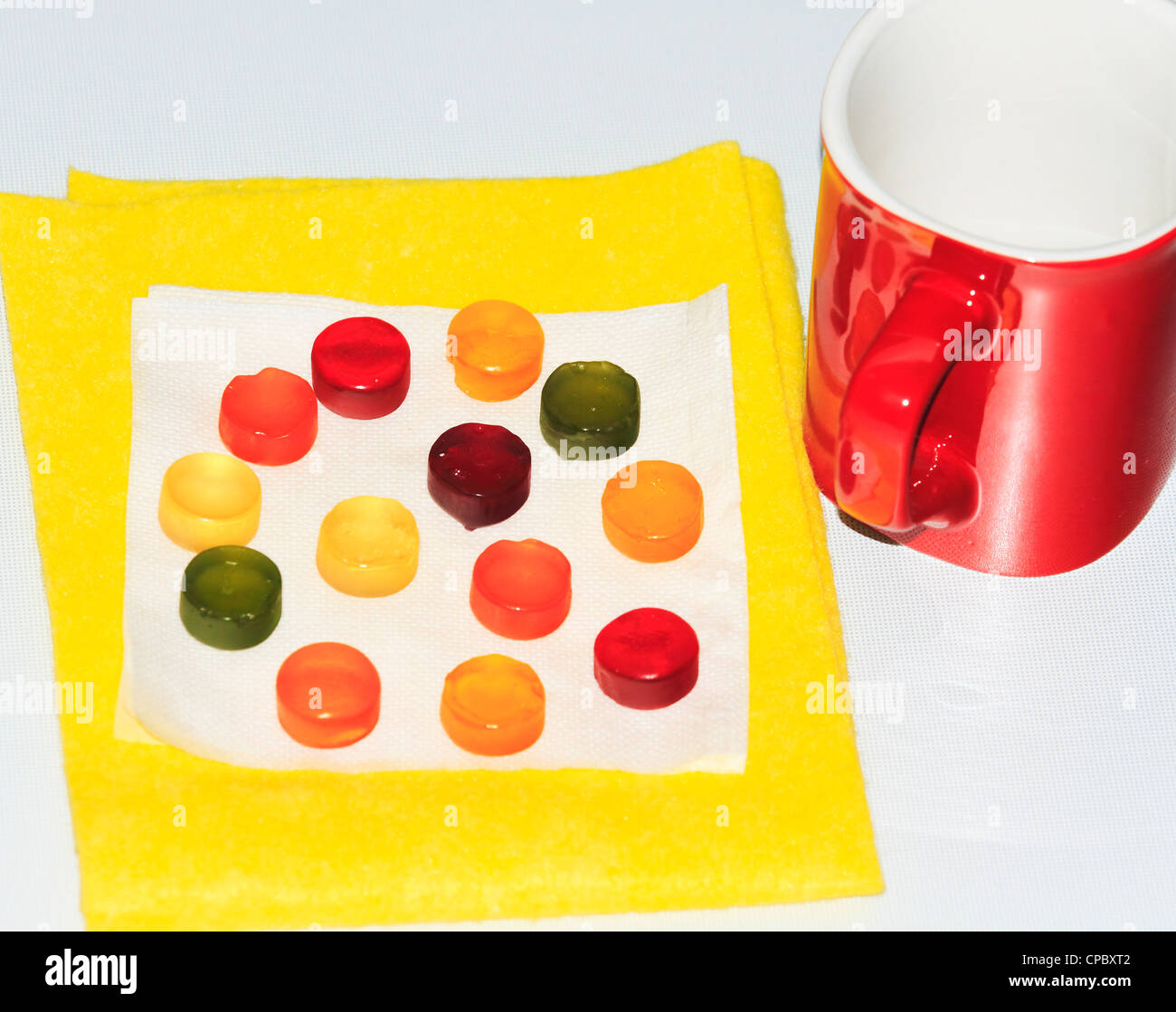 red cup, beautiful candy on white background - Stock Image