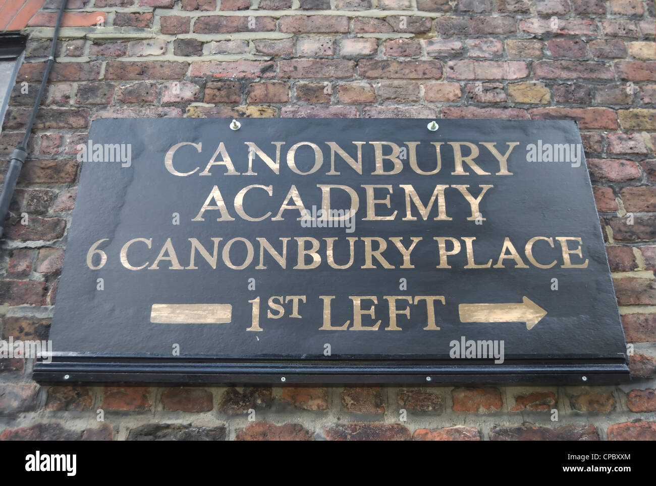 direction sign for canonbury academy, a meeting and function venue, islington, london, england - Stock Image