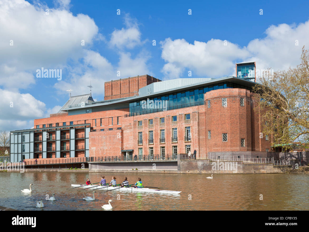 Rowers on the river avon in front of Royal Shakespeare company theatre stratford upon avon Warwickshire England - Stock Image
