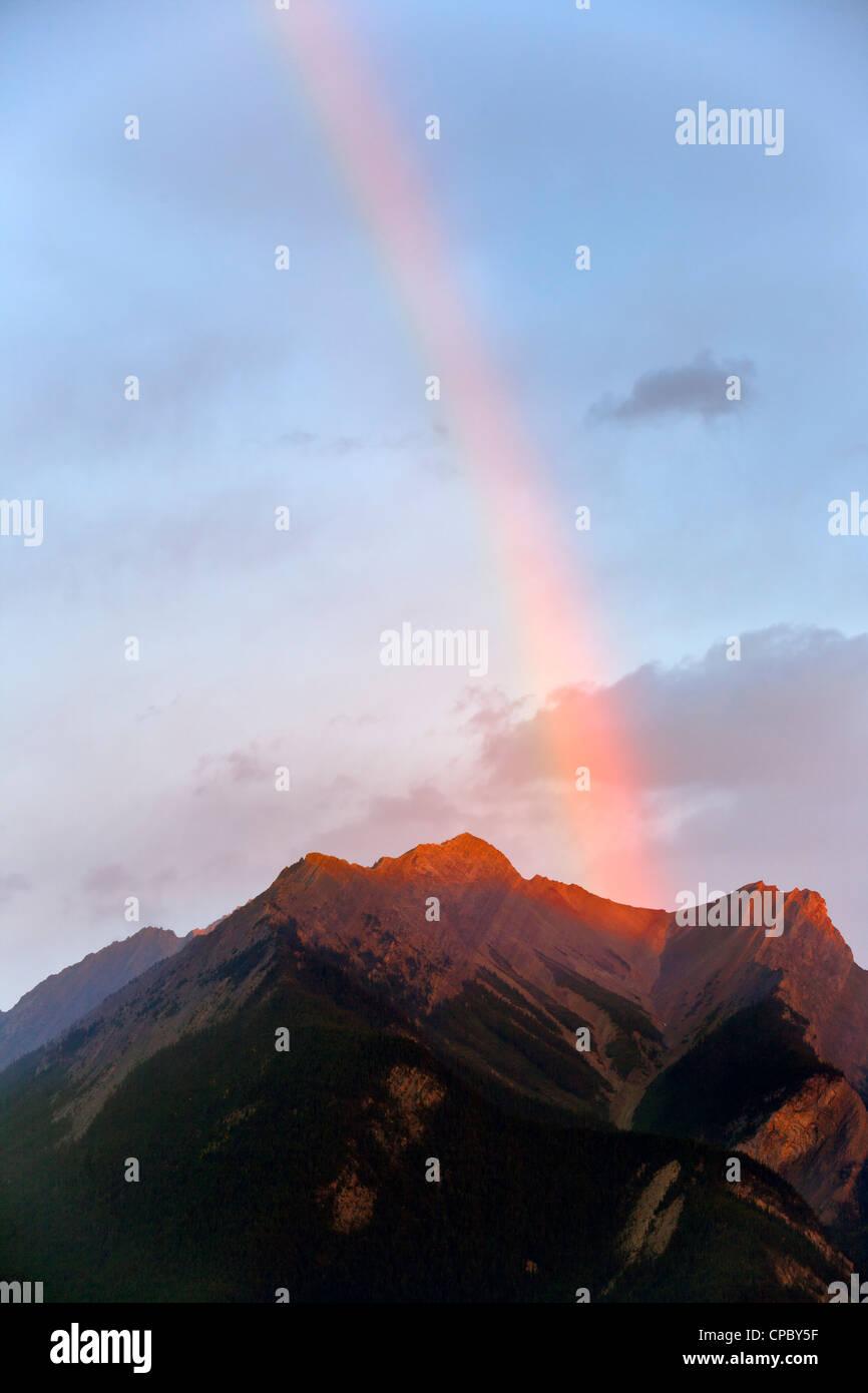 Rainbow over DeSmet range in autumn in the Canadian Rockies--Jasper National Park, Alberta, Canada. - Stock Image