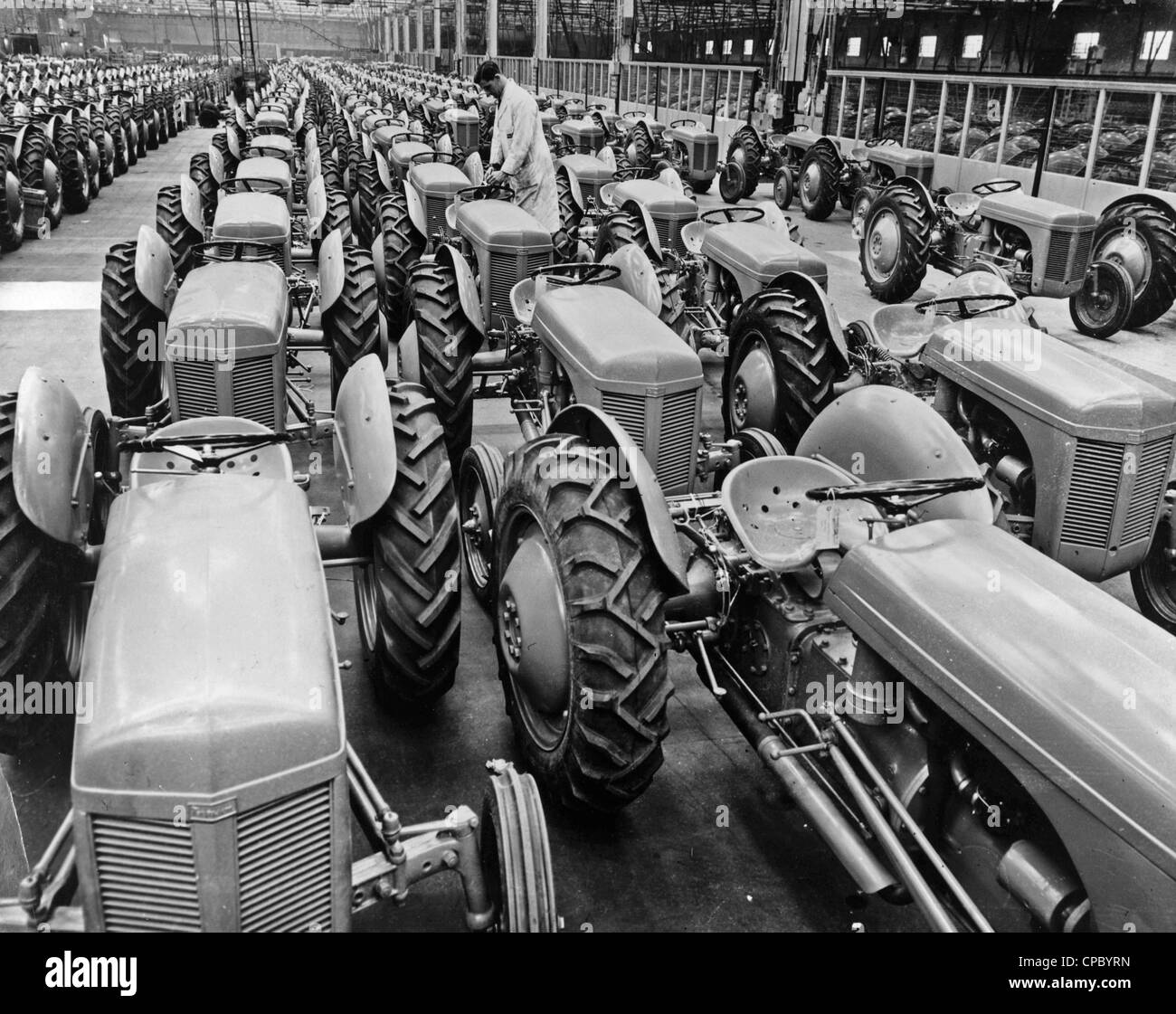Pic shows completed Ferguson tractors filling the bays at the Banner Lane Factory of Standard Motors. 1951. From - Stock Image