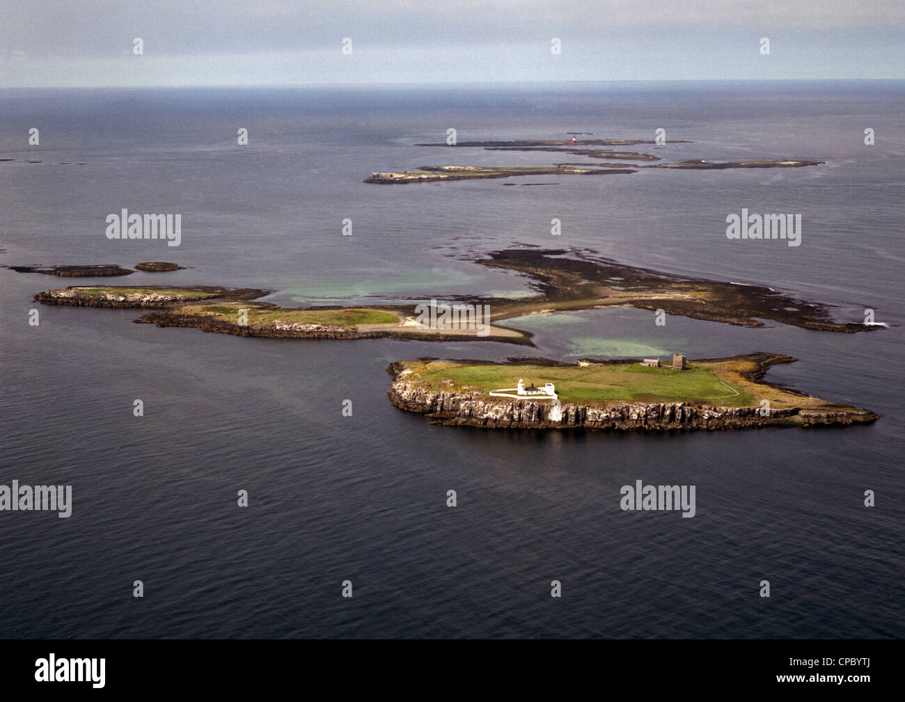 historic aerial view of the Farne Islands National Nature Reserve off the coast of Northumberland taken in August Stock Photo