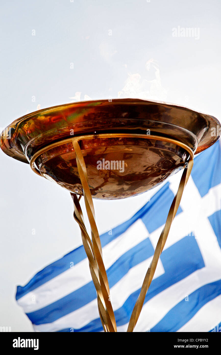 Olympic flame altar in front of Greek flag. Greece. - Stock Image
