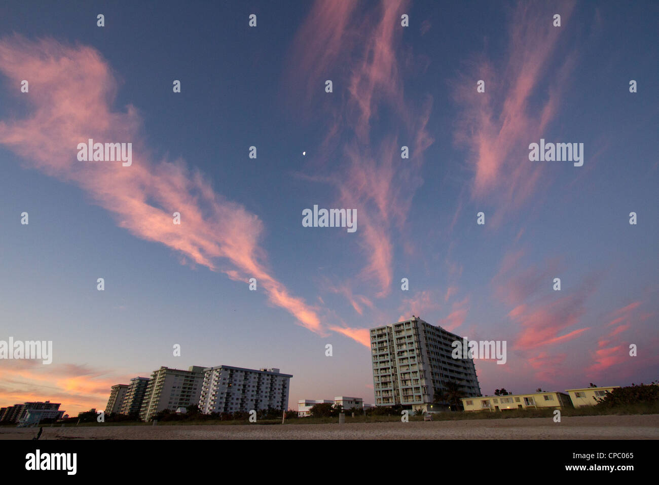 Wispy Red Clouds During Miami Sunrise - Stock Image