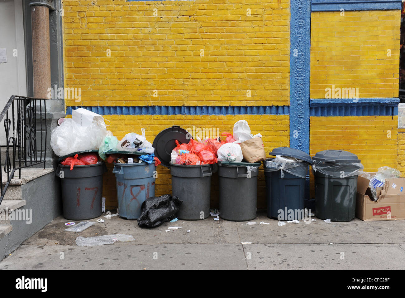 Rubbish Bins outside a restaurant Soho, New York - Stock Image