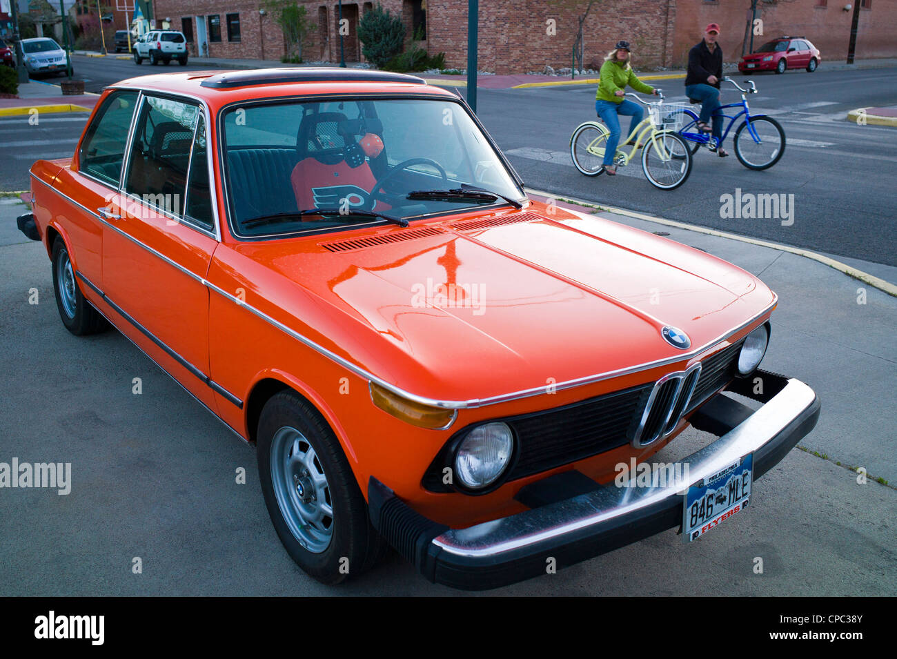 Old BMW sports car, painted orange & black in honor of the Philadelphia Flyers National Hockey Team Stock Photo