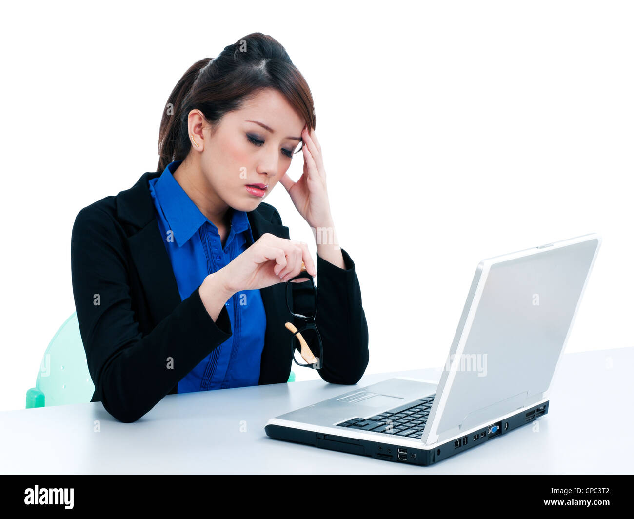 Tired businesswoman at work - Stock Image