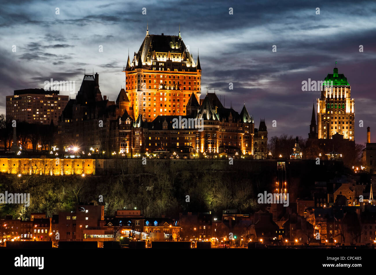 Chateau Frontenac and Old Quebec skyline at dusk from across the Saint Lawrence River in Levis, Quebec, Canada. - Stock Image