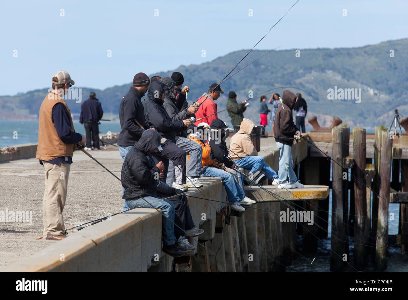 Fishermen on pier - Stock Image