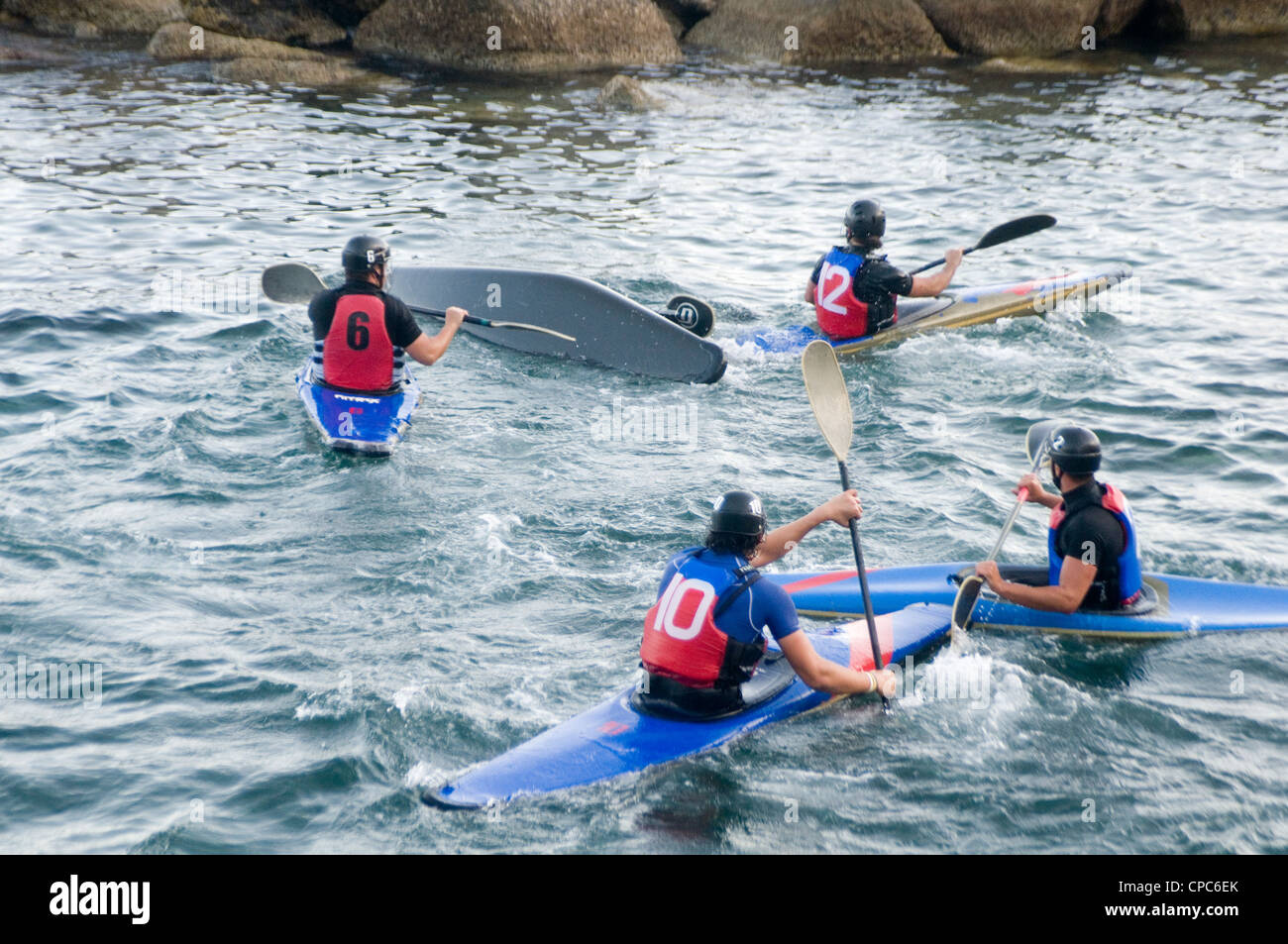 canoe canoes canoing water polo football net barrel roll rolling paddles paddles paddling team sport sports watersports - Stock Image