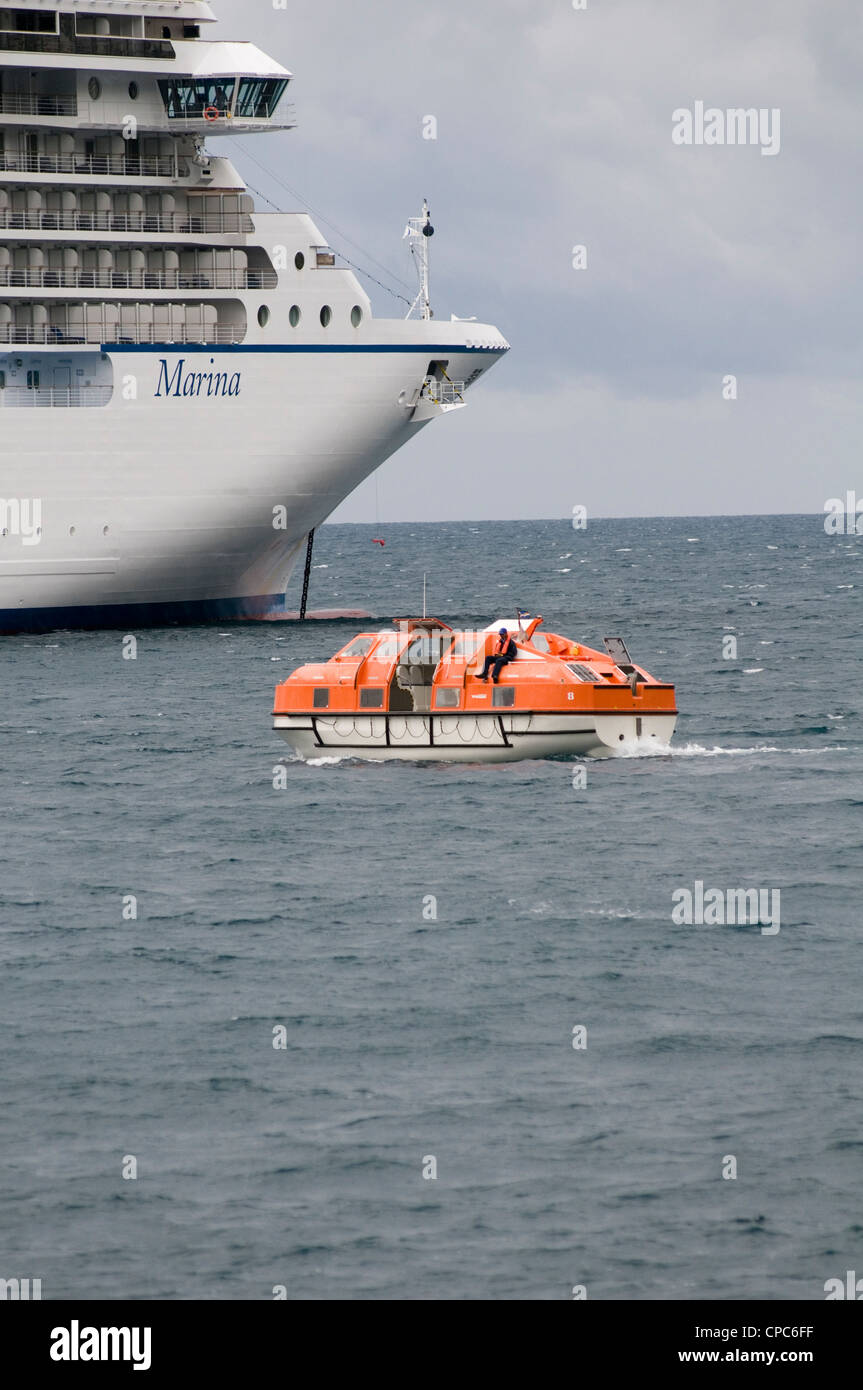 cruise ship cruiseship ships lifeboat life boat lifeboats MSC marina being used to ferry pssengers on day trips - Stock Image