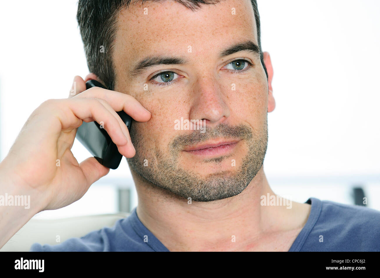 relaxed man with having a communication with a cellephone - Stock Image