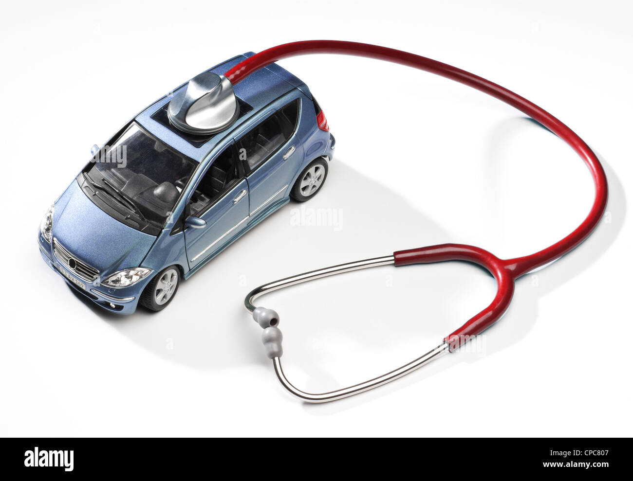 Model Car with stethoscope as a symbol for automotive service. - Stock Image