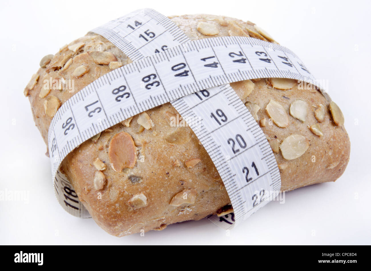 home baked roll with centimeter measuring tape - Stock Image