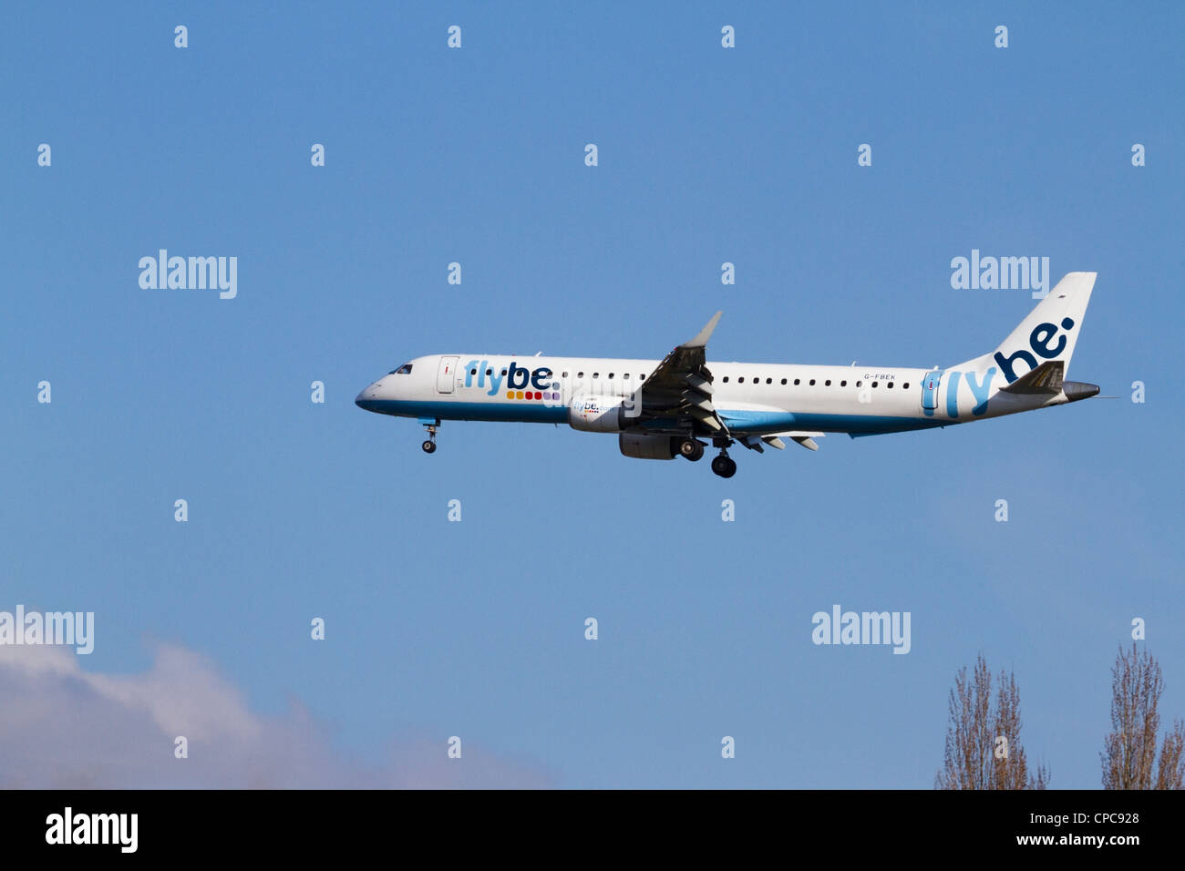Flybe aircraft with landing gear down ready to land at Southampton Airport, Hampshire - Stock Image