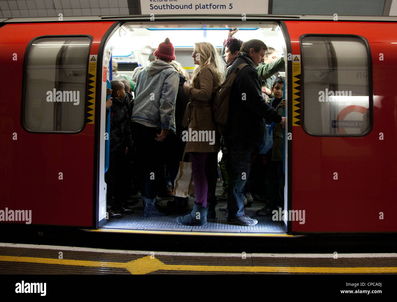 Crowded London Underground carriage during morning rush hour - Stock Image