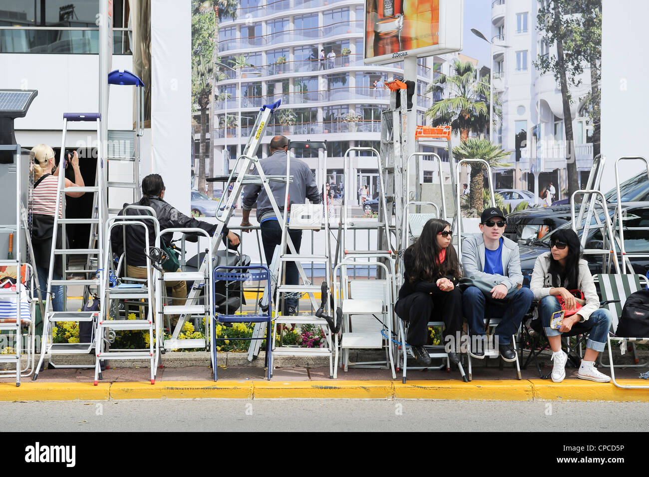 Autograph and film fans gather outside the Palais at the 65th Cannes Film Festival 2012 - Stock Image