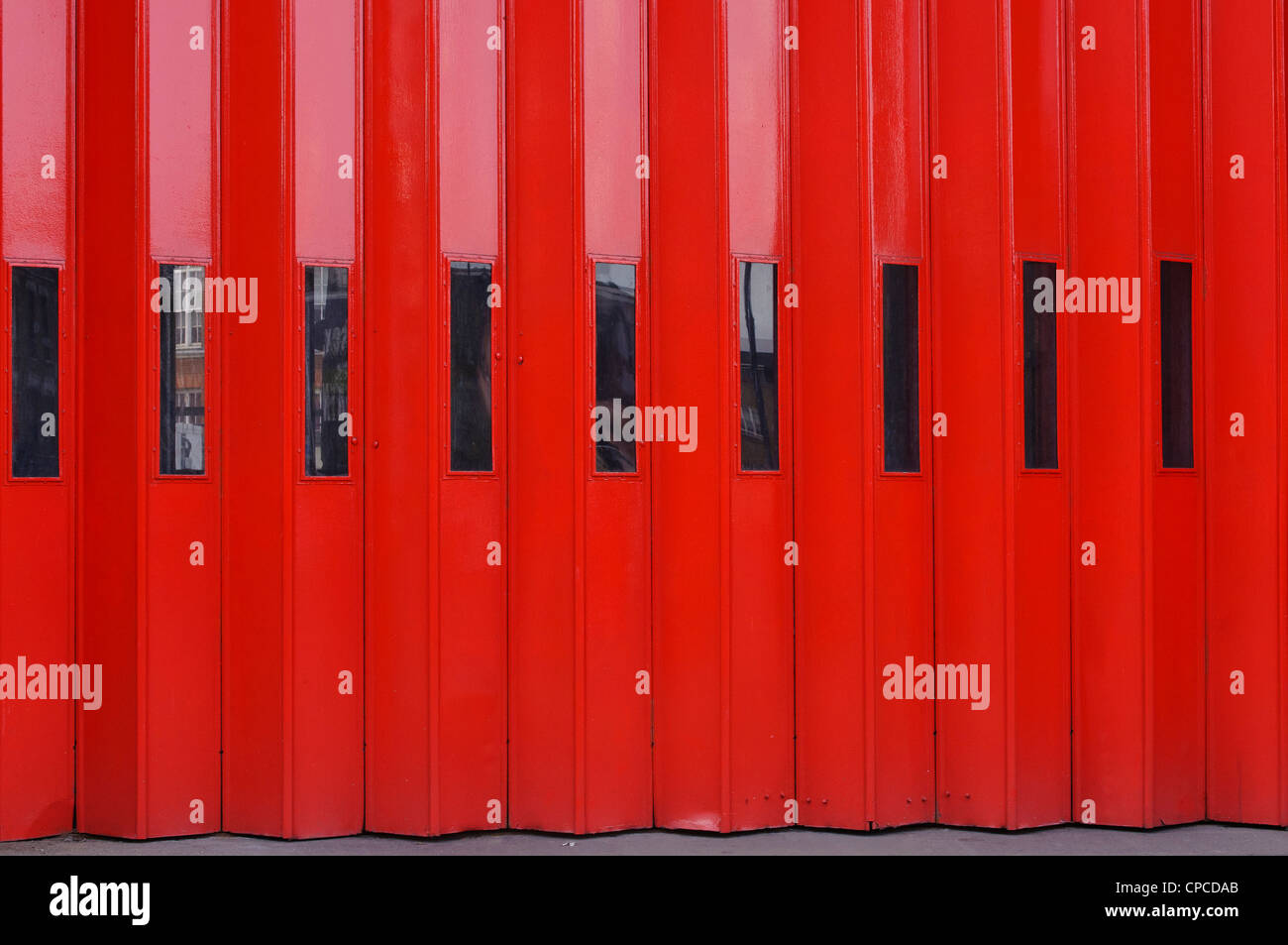 Bright red doors of a fire station in Old Street, London - Stock Image