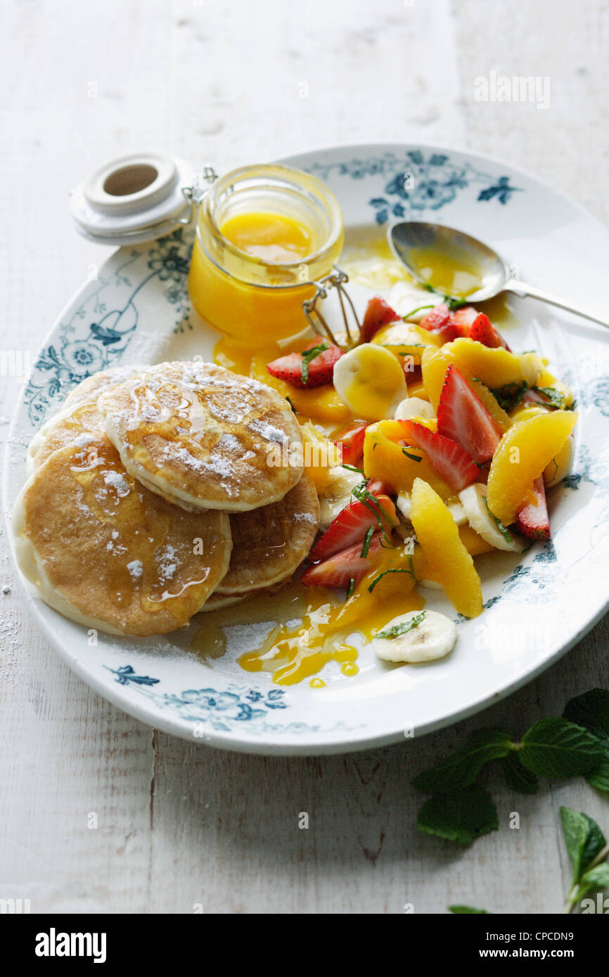 Plate of pancakes with fruit salad - Stock Image