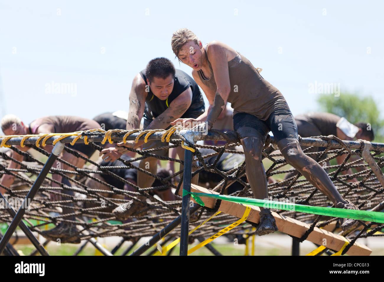 Mud race participants - Stock Image